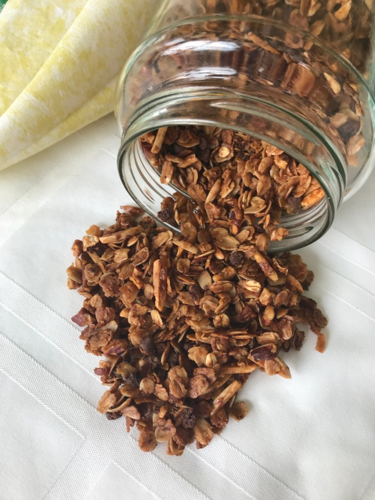 Almond pecan granola is full of flavor and really easy to make. Perfect for a yogurt parfait or with milk.