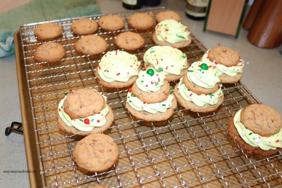 Brown sugar pecan Christmas tree cookies partially assembled on a cooling rack.