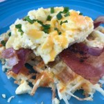 Cheddar and Chive Eggs over Cheesy Hash Brown Waffles are a fun brunch or Sunday morning breakfast.
