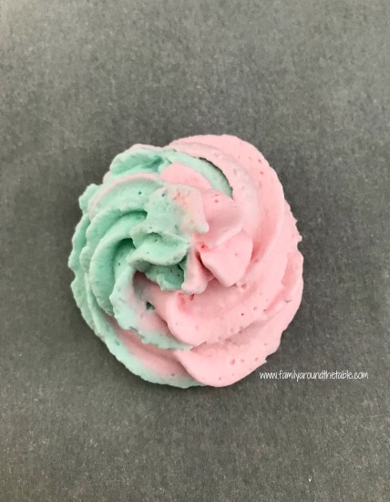 Mermaid swirl whipped cream is a fun addition to cupcakes or an ice cream cake.