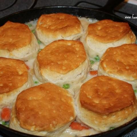 Turkey biscuit stew in a cast iron skillet.