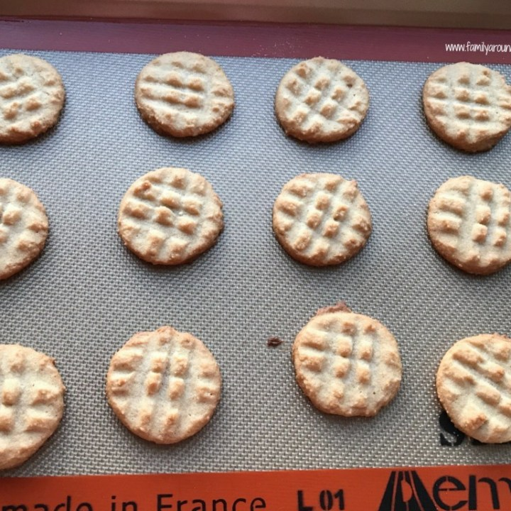 Peanut butter cookies on a cookie sheet.
