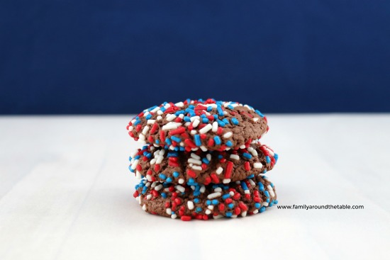 A stack of chocolate cookies with red, white and blue sprinkles