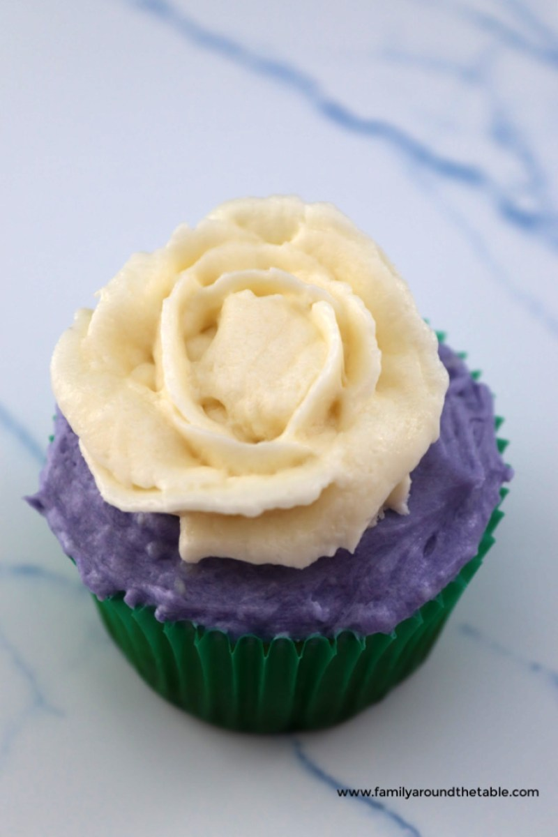 White chocolate buttercream rose on a cupcake.