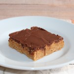 A slice of lunch lady peanut butter bars on a white plate.