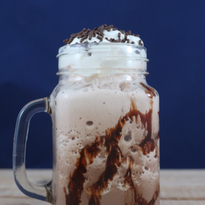 Frozen hot chocolate in a mason jar glass.
