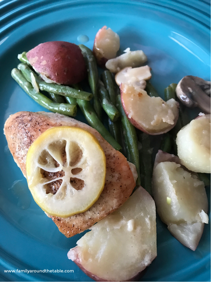 Overhead shot of lemon chicken and vegetables on a plate.