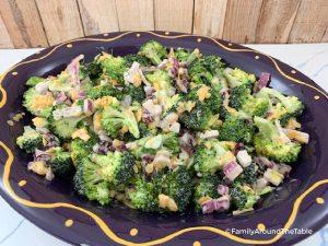 Broccoli salad in a purple bowl.