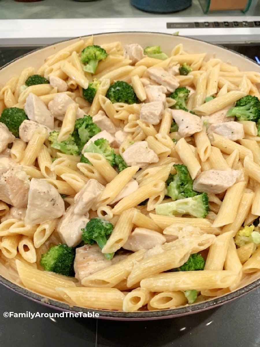 Pasta, broccoli and chicken in a skillet.