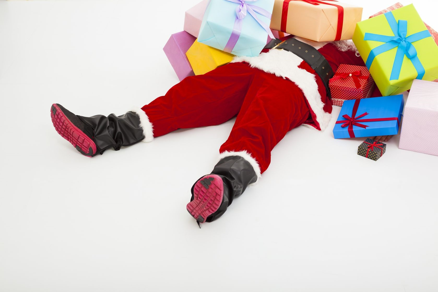 32315808 - santa claus too tired to lie on floor with many gift boxes over white