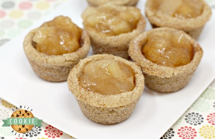 Snickerdoodle Apple Pie Cookie Cups combine two favorite desserts in a bite sized treat that is full of cinnamon and apple pie filling!