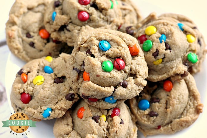 Monster Cookies are made with peanut butter, chocolate chips, M&Ms and oatmeal! All of your favorite cookie flavors combined in one delicious cookie!