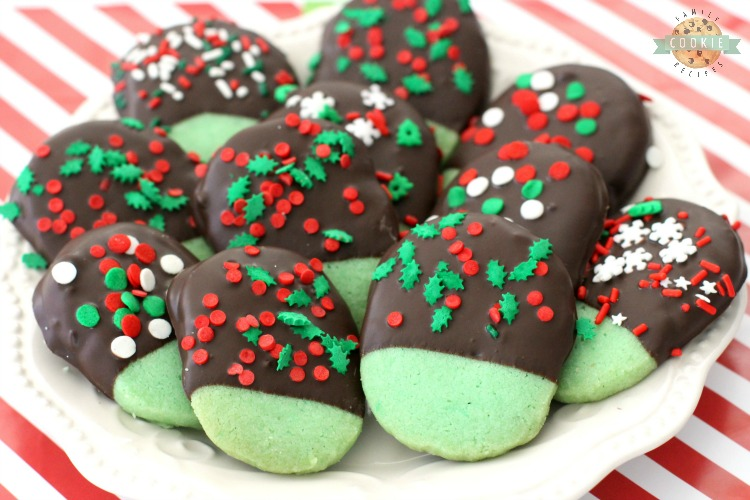 Mint Christmas Cookies made from a buttery shortbread cookie dipped in chocolate & topped with holiday sprinkles. Mint flavored Christmas Cookies perfect for cookie exchanges and gift plates!