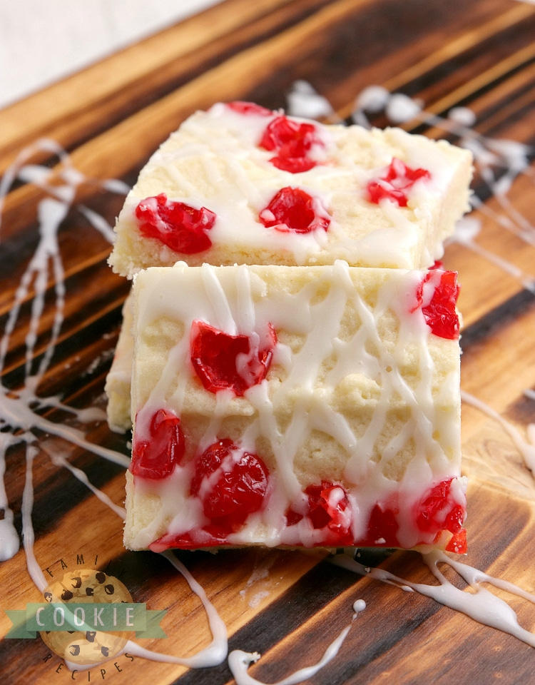 Sugar cookie bars topped with cherries and glaze