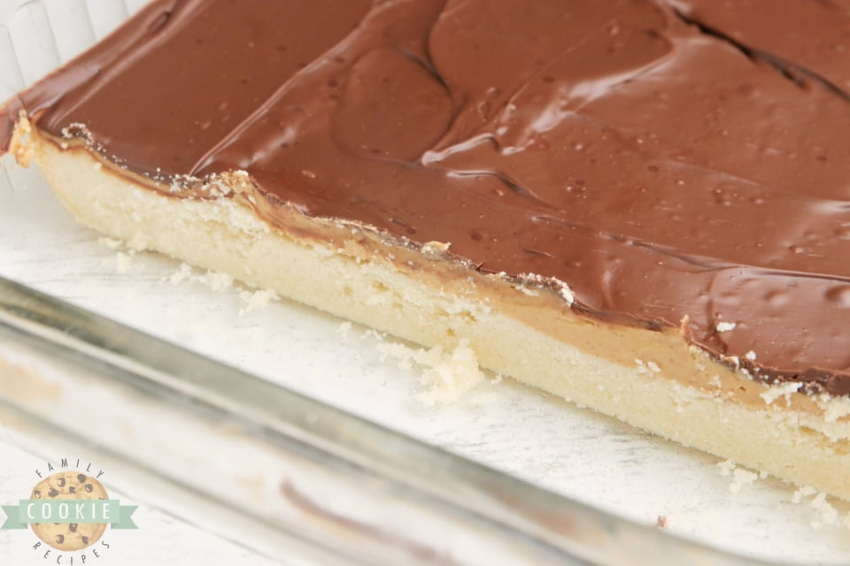 Tagalong Cookie Bars made with a shortbread cookie crust with a peanut butter layer with chocolate on top. Simple to put together, and taste just like your favorite chocolate peanut butter Girl Scout cookies.