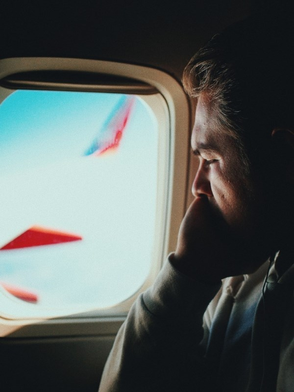 Man fear of flying aeroplane window