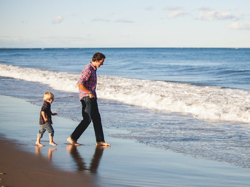Single father with son on beach