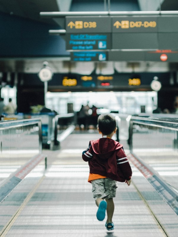 Little boy running in airport