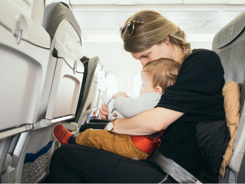 Newborn baby traveling on aeroplane
