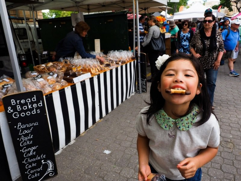 Salamanca Markets Hobart Girl eating biscuit