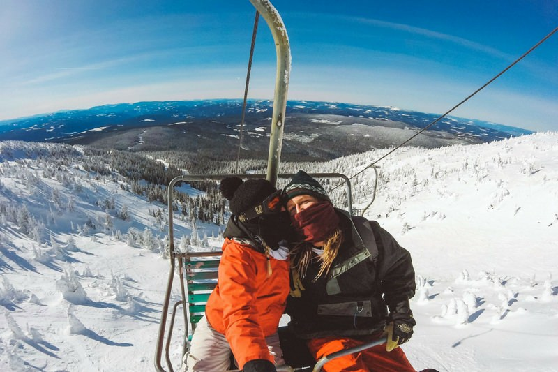 Big White Canada Chair Lift Couple Kissing