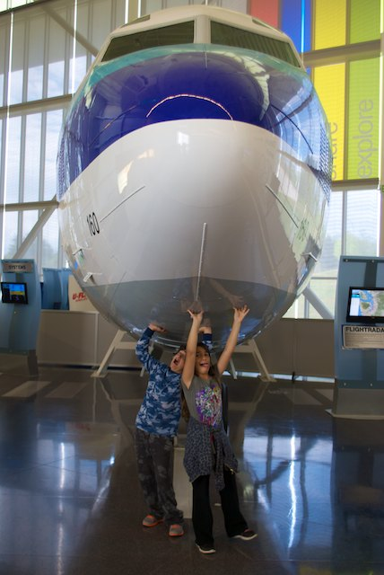 The kids playing under a 707's fuselage