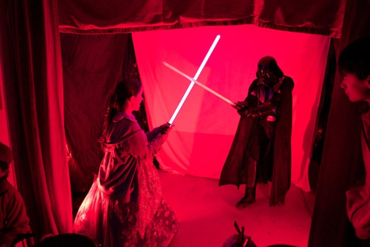 Some houses had live attractions - here, Raquel stages a light saber duel with Darth Vader himself (she won)
