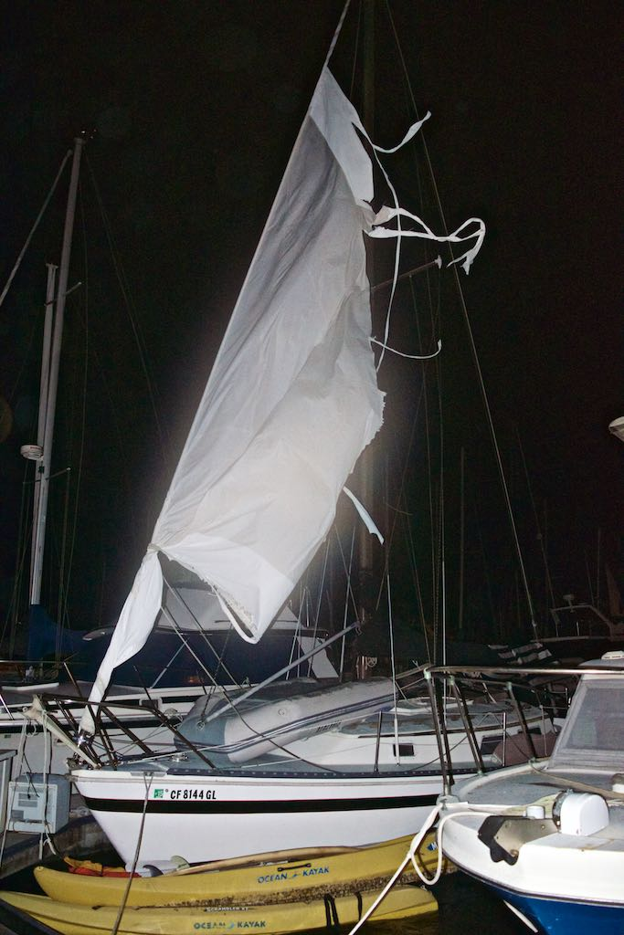 A headsail blown out of its furling. Flapping hopelessly and violently to the wind - and being quickly destroyed in the process.
