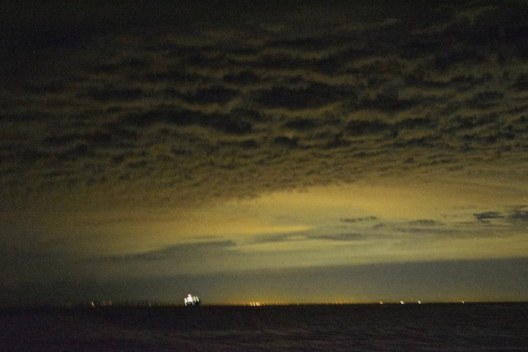 A cruise ship maneuvers two miles away. Note the clouds, their eerie appearance augmented by the lights of Los Angeles