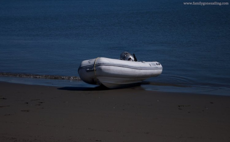 Beached on Eureka harbor in October last year. Note that we can't pull it too far from the water, causing two problems: the sea keeps trying to take it away, requiring a constant and close watch from at least one of us, and the waves slapping on it end up filling it with salt water and sand.