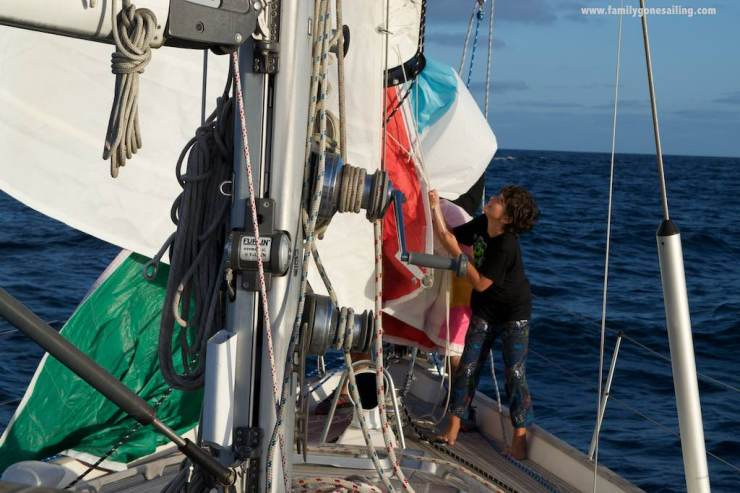 The kids helping with the spinnaker