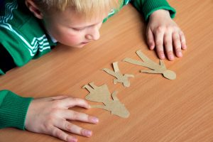 Child doing jigsaw - divorce lawyer