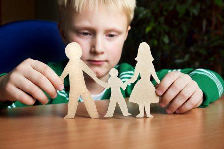 boy with parents cutout figures