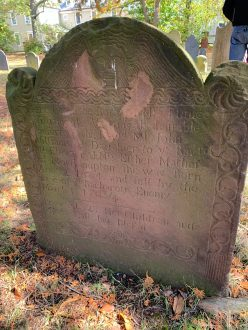 """Eunice Williams' gravestone in Historic Deerfield's Old Cemetery in Deerfield, Massachusetts. Carved on the stone are the details of her death: """"and fell by the rage of ye Barbarous Enemy March 1 1703/4"""""""