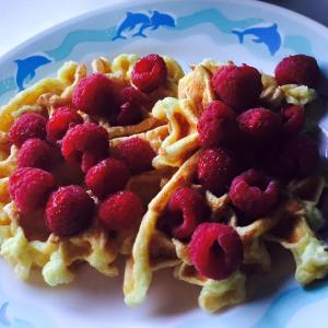 Lemon protein waffles with fresh raspberries & a coffee to go.