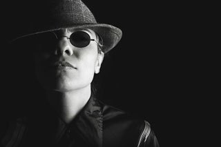 Gangster in sunglasses and Fedora