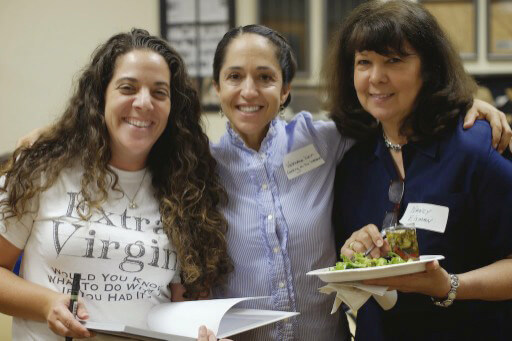author Laura Bashar with foodie friends