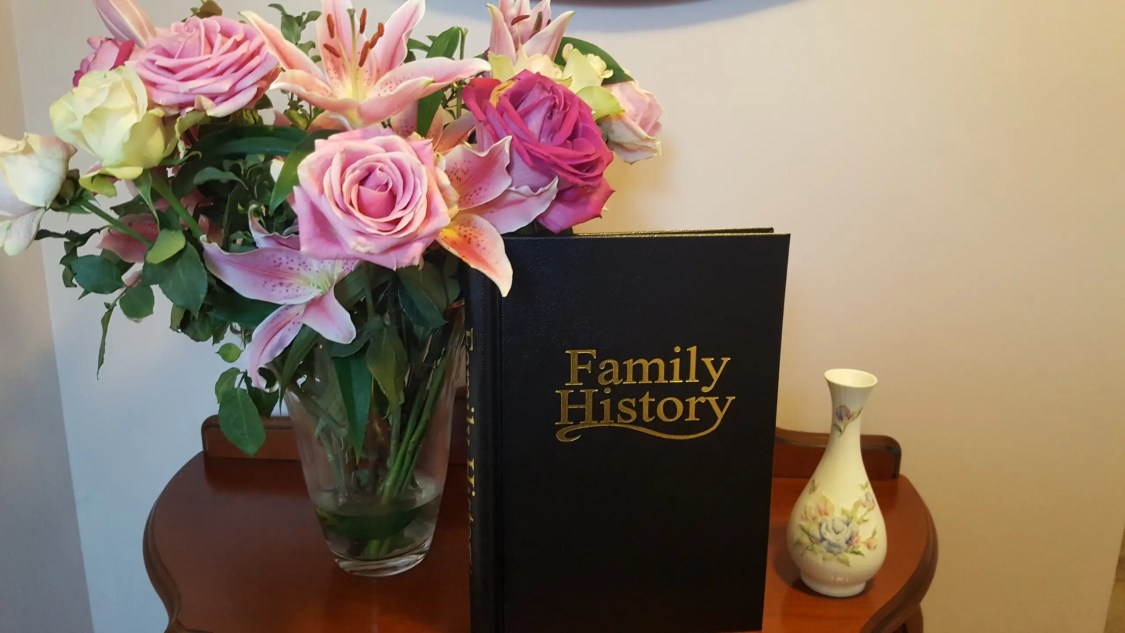 Family History Binder and Flowers