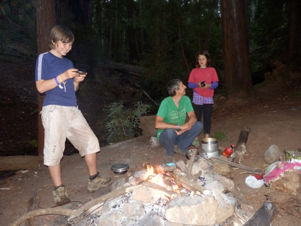 Camp fire fun amongst some redwoods.