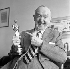 Stan Laurel holds Academy Awards Oscar presented to him for his creative pioneering in the field of cinema comedy on July 11, 1961. (AP Photo/Don Brinn)