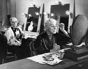 Buster Keaton and Charlie Chaplin applying makeup for Calvero's final performance