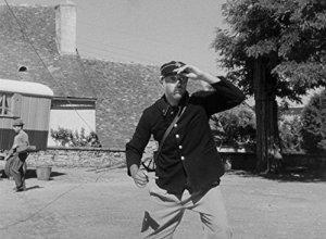Photo of Jacques Tati as postman in Jour de Fete