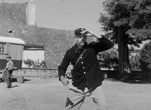 Photo of Jacques Tati as postman in Jour de Fete
