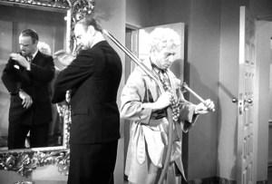 Harpo vacuums the toupee off of Sig Ruman's head