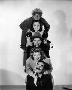 Harpo, Ann Miller, Chico, Lucille Ball, and Groucho in a publicity photo from Room Service