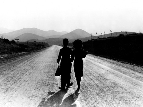 Charlie Chaplin and Paulette Goddard walking off into the sunset aat the end of Modern Times