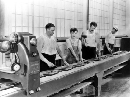 Charlie Chaplin and Tiny Sandford working on the assembly line in Modern Times