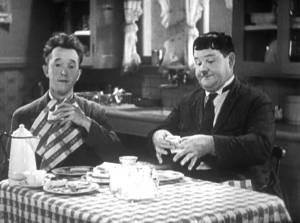 Stan Laurel and Oliver Hardy eating in One Good Turn