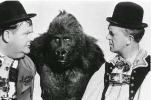 Oliver Hardy, the gorilla, and Stan Laurel in a publicity photo for Swiss Miss