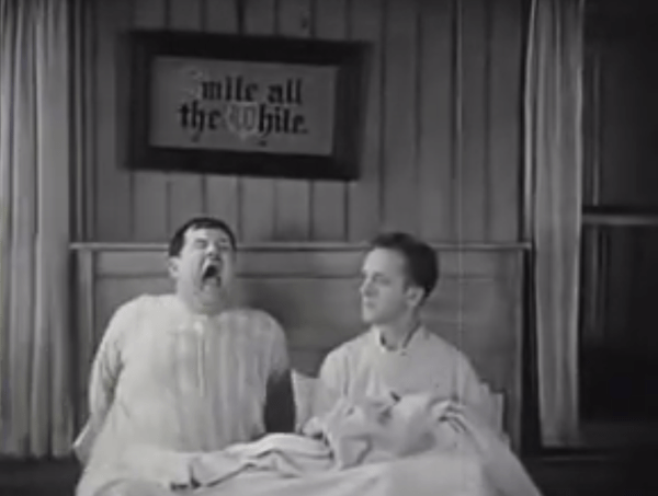 They Go Boom! Oliver Hardy sneezing keeps Stan Laurel awake
